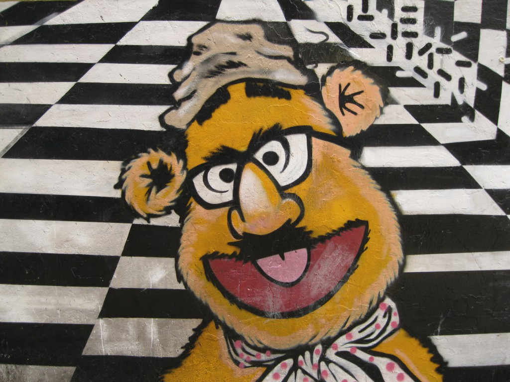 Mural on a side street from 18th Street in Pilsen. A Fozzie Bear and Groucho Marx Combo.