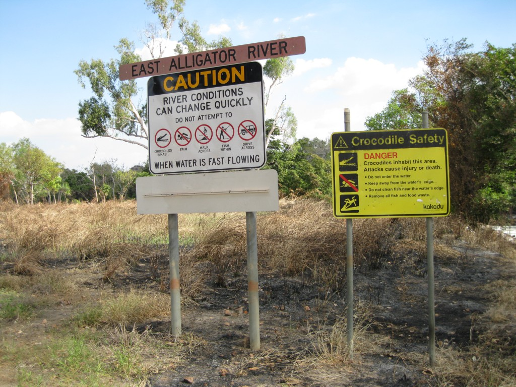 Road signs at East Alligator River right at the border to Kakadu National Park on the Arnhem Land side