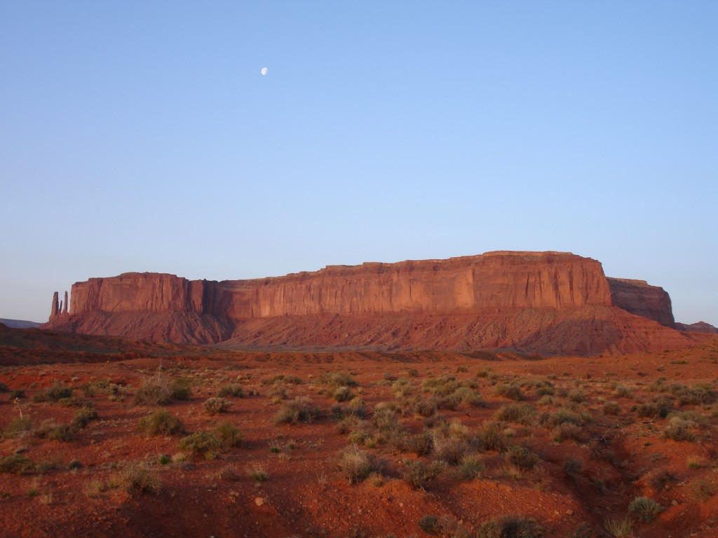 The Three Sisters and Mitchell Mesa at Sunrise with the Moon above
