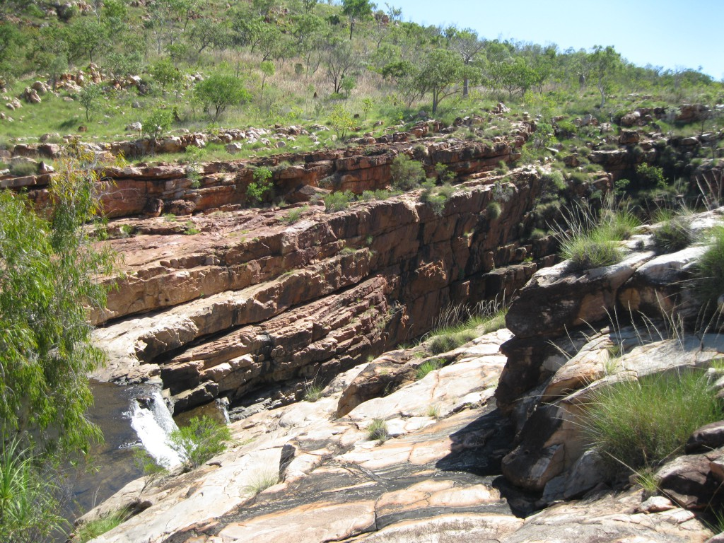 Bell Gorge Falls and a view of steep rock walls of the Gorge