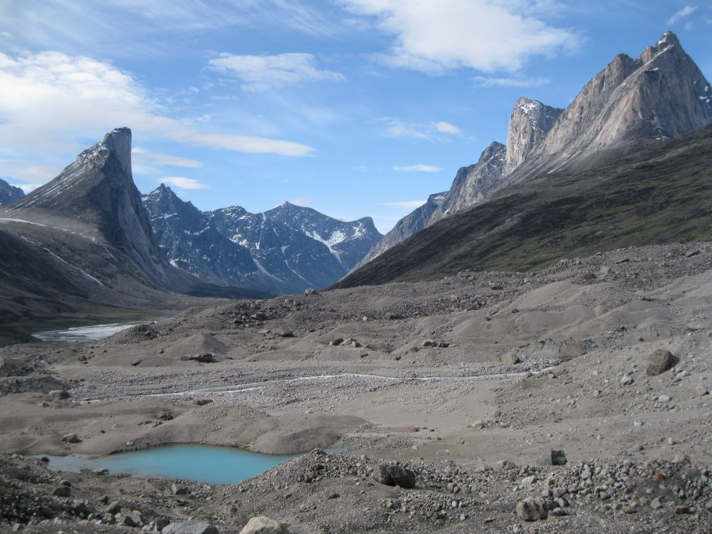 Mount Thor and Mount Northumbria fronted by a small lake and a stream