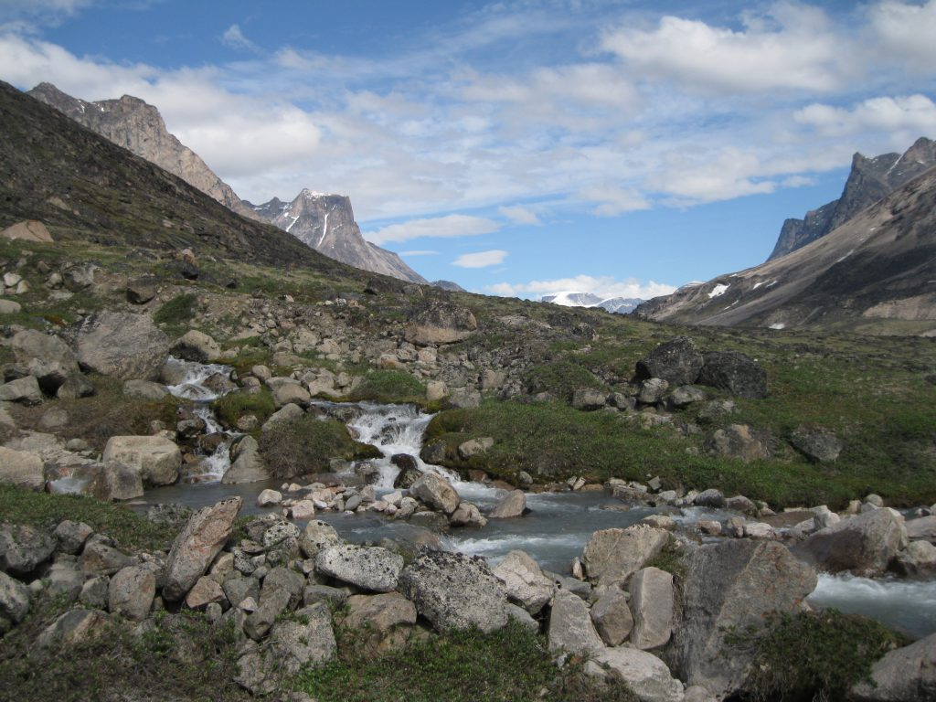 The valley, a stream and cascades with the Highway Glacier in the distance