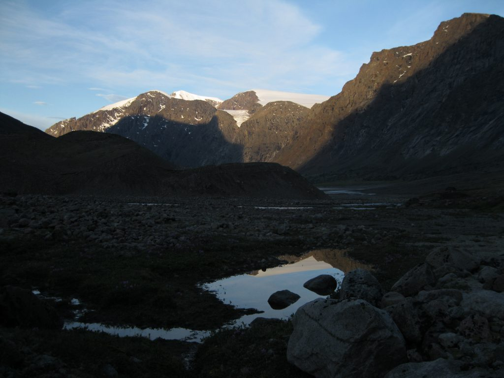 Sunlight on Peaks and Glaciers with Reflection in a pond between Windy Lake and Schwarzenbach Falls