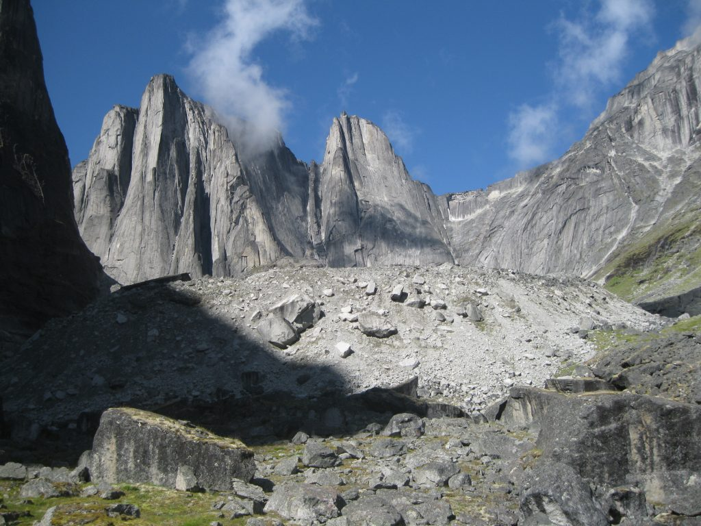 Nahanni national park reserve northwest territories journeyscope from left to right tara tower lotus flower tower tathagata parrot beak peak and mount sir james mcbrien fronted by boulders at the cirque of the izmirmasajfo