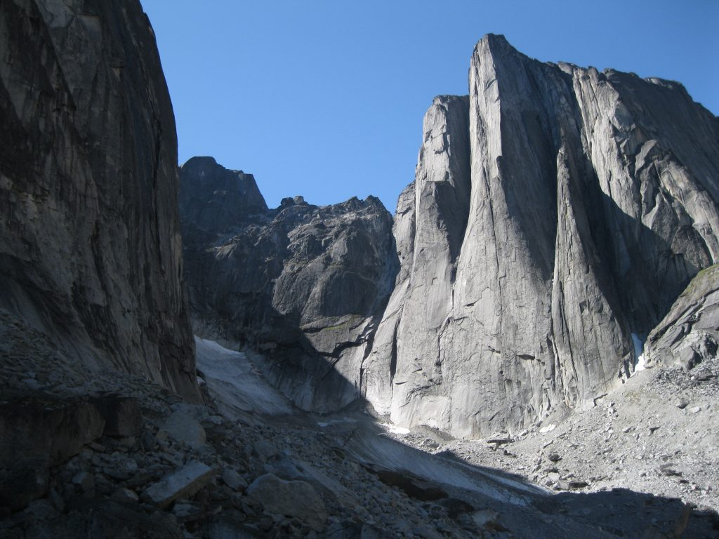 Nahanni national park reserve northwest territories journeyscope right next to a massive rock wall from left to right the middle and west huey spires tara tower and lotus flower tower at the cirque of the unclimbables izmirmasajfo